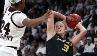 Missouri guard Sophie Cunningham (3) is defended by Mississippi State guard Jordan Danberry (24) during the second half of an NCAA college basketball game Thursday, Feb. 14, 2019, in Starkville, Miss. Missouri won 75-67. (AP Photo/Rogelio V. Solis)