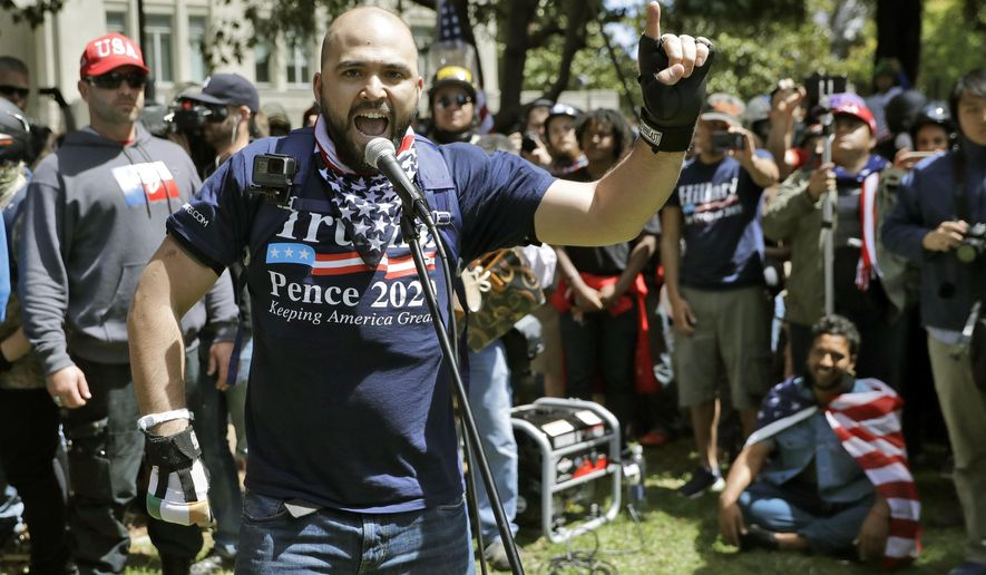"""FILE - In this April 27, 2017, file photo, Joey Gibson speaks during a rally in support of free speech in Berkeley, Calif. The mayor of Portland, Oregon, has asked the police chief to investigate """"disturbing"""" texts between the commander of the department's rapid response team and Gibson the leader of a far-right group involved in violent protests in the city. (AP Photo/Marcio Jose Sanchez, File)"""