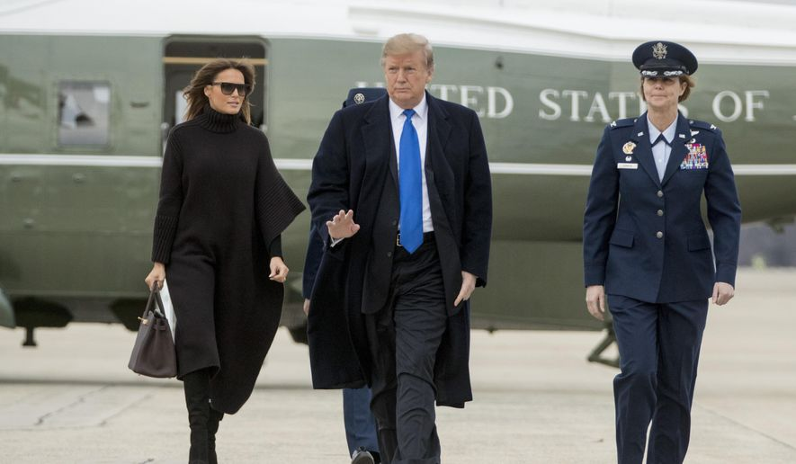 President Donald Trump and first lady Melania Trump walk toward Air Force One at Andrews Air Force Base, Md., Friday, Feb. 15, 2019, to travel to Palm Beach, Fla. (AP Photo/Andrew Harnik)