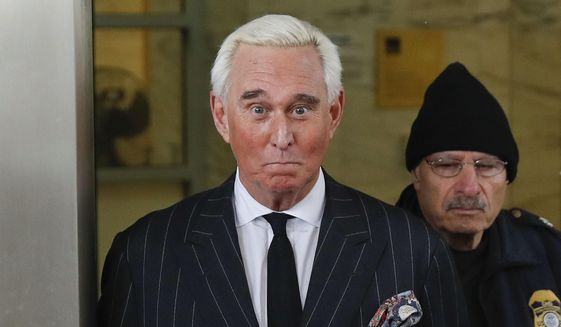 In this Feb. 1, 2019 photo, former campaign adviser for President Donald Trump, Roger Stone, leaves federal court in Washington. (AP Photo/Pablo Martinez Monsivais)