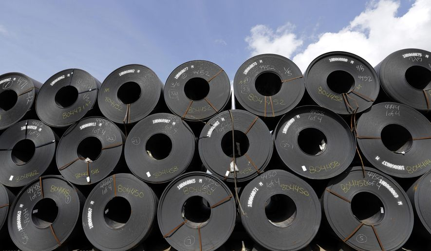 FILE - In this June 5, 2018, file photo, rolls of steel are shown in Baytown, Texas. Despite President Donald Trump's tough talk on trade, his administration has granted hundreds of companies permission to import millions of tons of steel made in China, Japan and other countries without paying the hefty tariff he put in place to protect U.S. manufacturers and jobs, according to an Associated Press analysis.(AP Photo/David J. Phillip, File)