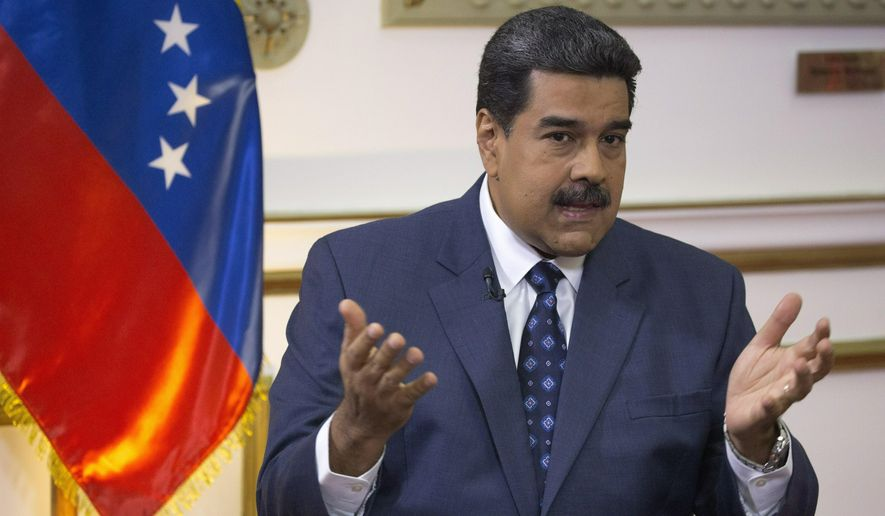 Venezuela's President Nicolas Maduro speaks during an interview with The Associated Press at Miraflores presidential palace in Caracas, Venezuela, Thursday, Feb. 14, 2019. Even while criticizing Donald Trump's confrontational stance toward his socialist government, Maduro said he holds out hope of meeting the U.S. president to resolve an impasse over his recognition of opponent Juan Guaido as Venezuela's rightful leader. (AP Photo/Ariana Cubillos)