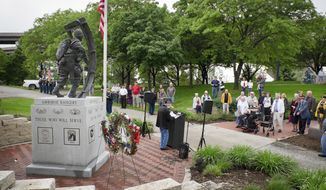 In this May 24, 2015 photo, Terry Zahn, president of the Midwest Chapter of the 101st Airborne Division Association gives the introduction at the Heartland Airborne Memorial Association's service at Heartland of America Park in Omaha, Neb. This war memorial will be moved to Memorial park as Omaha's riverfront is going to be revamped. (Kent Sievers/Omaha World-Herald via AP)