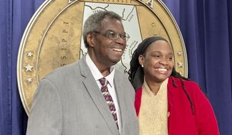 In this Thursday, Feb. 14, 2019 photo, former Alabama State Sen. Hank Sanders, left, a nine-term member of the Alabama Legislature, who is being replaced in the Alabama Senate by his daughter Sen. Malika Sanders-Fortier, right, attend a press conference to discuss preparation for the annual voting rights match commemoration in Selma, Ala. Sanders-Fortier was elected in November. (AP Photo/Kim Chandler)