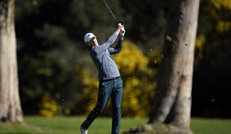 Jordan Spieth hits his second shot on the 13th hole as second round play continues during the Genesis Open golf tournament at Riviera Country Club on Saturday, Feb. 16, 2019, in the Pacific Palisades area of Los Angeles. (AP Photo/Ryan Kang)