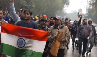 Indians protestor shouts slogans against Thursday's attack on a paramilitary to the Indian soldiers killed in Thursday's attack on a paramilitary convoy in Kashmir, in Prayagraj, Uttar Pradesh state, India, Friday, Feb. 15, 2019. The death toll from a car bombing on a paramilitary convoy in Indian-controlled Kashmir has climbed to at least 40, becoming the single deadliest attack in the divided region's volatile history, security officials said Friday. (AP Photo/ Rajesh Kumar Singh)
