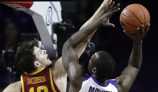 Iowa State forward Michael Jacobson (12) fouls Kansas State forward Makol Mawien (14) during the first half of an NCAA college basketball game in Manhattan, Kan., Saturday, Feb. 16, 2019. (AP Photo/Orlin Wagner)