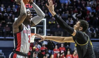 Mississippi guard Terence Davis (3) is defended by Missouri's Javon Pickett (4)  during an NCAA college basketball game in Oxford, Miss., Saturday, Feb. 16, 2019. (Bruce Newman/The Oxford Eagle via AP)