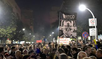 "People march during a protest against President Milo Djukanovic in Montenegro's capital Podgorica, Saturday, Feb. 16, 2019. Several thousand people have rallied in Montenegro demanding the resignation of long-serving President Milo Djukanovic's government over allegations of corruption. The crowd has marched through the capital of Podgorica chanting ""Milo thief"" and carrying banners reading ""No more crime"" or ""Rebellion."" (AP Photo/Risto Bozovic)"
