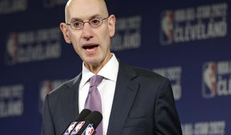 FILE - In this Nov. 1, 2018 file photo, NBA Commissioner Adam Silver announces that the Cleveland Cavaliers will host the 2022 NBA All Star game during a news conference in Cleveland. The NBA is bringing a pro league to Africa. The Basketball Africa League, a new collaboration between the NBA and the sport's global governing body FIBA, was announced Saturday, Feb. 16, 2019. (AP Photo/Tony Dejak, File)