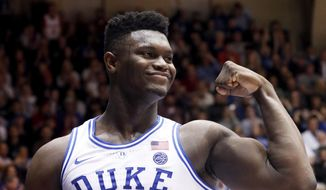 Duke's Zion Williamson (1) celebrates after he scored against North Carolina State during the second half of an NCAA college basketball game in Durham, N.C., Saturday, Feb. 16, 2019. (AP Photo/Chris Seward) **FILE**
