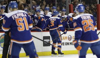 New York Islanders' Ryan Pulock (6) celebrates with teammates after scoring a goal during the second period of an NHL hockey game against the Edmonton Oilers on Saturday, Feb. 16, 2019, in New York. (AP Photo/Frank Franklin II)