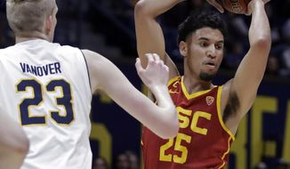 Southern California's Bennie Boatwright, right, looks to pass the ball away from California's Connor Vanover (23) in the first half of an NCAA college basketball game Saturday, Feb. 16, 2019, in Berkeley, Calif. (AP Photo/Ben Margot)