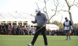 J.B. Holmes celebrates with a fist pump after making his putt on the 18th green to win the Genesis Open golf tournament at Riviera Country Club on Sunday, Feb. 17, 2019, in the Pacific Palisades area of Los Angeles. (AP Photo/Ryan Kang)