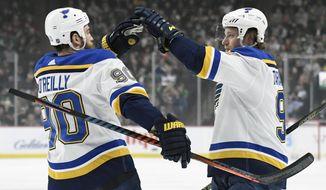 St. Louis Blues' Ryan O'Reilly (90) congratulates teammate Vladimir Tarasenko (91), of Russia on scoring a goal against the Minnesota Wild during the first period of an NHL hockey game Sunday, Feb. 17, 2019, in St. Paul, Minn. (AP Photo/Hannah Foslien)