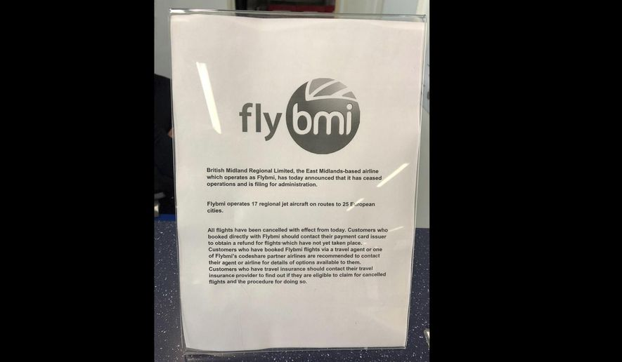 A notice informing passengers that flybmi flights have been cancelled following the collapse of the airline, at Bristol Airport in Bristol, England, Sunday, Feb. 17, 2019. Hundreds of passengers have been stranded by the abrupt collapse of the British regional airline Flybmi. The airline says it's filing for administration _ a British version of bankruptcy because of higher fuel costs and uncertainty caused by Britain's upcoming departure from the European Union. (PA via AP)