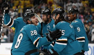 San Jose Sharks' Timo Meier (28) celebrates with Erik Karlsson (65) and Evander Kane (9) after scoring against the Vancouver Canucks during the first period of an NHL hockey game Saturday, Feb. 16, 2019, in San Jose, Calif. (AP Photo/Josie Lepe)