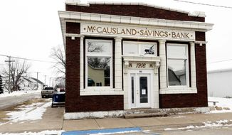 This Jan. 18, 2019 photo shows the McCausland Savings Bank in McCausland, Iowa. The city bought the 1916 landmark  in 2015 to keep it from being demolished. The structure was restored as a multi-purpose building, housing city offices and community center. (Kevin E. Schmidt/Quad City Times via AP)