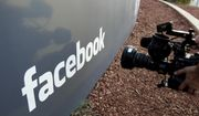 In this May 18, 2012, file photo a television photographer shoots the sign outside of Facebook headquarters in Menlo Park, Calif. (AP Photo/Paul Sakuma, File) **FILE**