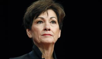 FILE - In this Jan. 18, 2018, file photo, Iowa Gov. Kim Reynolds delivers her inaugural address in Des Moines, Iowa. Nearly 50 years after Iowa moved to reduce partisanship in its court system, Republicans who control the governor's office and the Legislature say it's time to give politicians greater control. (AP Photo/Charlie Neibergall, File)