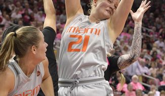 Miami forward Emese Hof (21) pulls down a rebound during the second half of an NCAA college basketball game against Louisville in Louisville, Ky., Sunday, Feb. 17, 2019. Miami won 79-73. (AP Photo/Timothy D. Easley)