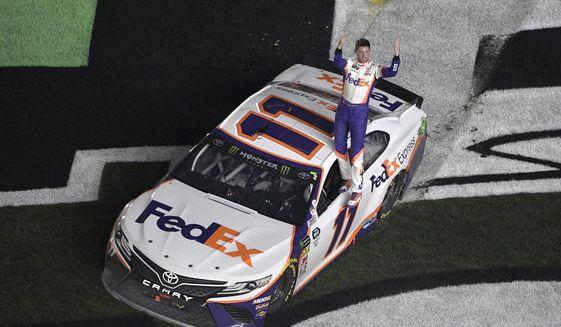 Denny Hamlin (11) celebrates after winning the NASCAR Daytona 500 auto race at Daytona International Speedway Sunday, Feb. 17, 2019, in Daytona Beach, Fla. (AP Photo/Phelan M. Ebenhack)