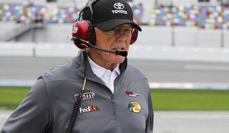 In this Sunday, Feb. 10, 2019 photo, car owner Joe Gibbs walks down pit road during qualifying for the Daytona 500 auto race at Daytona International Speedway, , in Daytona Beach, Fla. (AP Photo/Terry Renna)