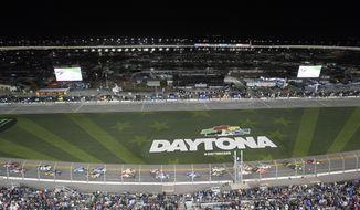 Drivers take the green flag on the start of the first of two qualifying races for the NASCAR Daytona 500 auto race at Daytona International Speedway Thursday, Feb. 14, 2019, in Daytona Beach, Fla. (AP Photo/Phelan M. Ebenhack)