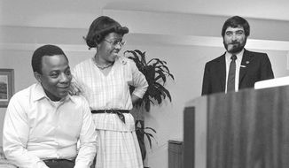 FILE - In this May 17, 1983 file photo, W. Wilson Goode and his wife Velma smile as they react to the news on television of a heavy black voter turn out in west Philadelphia in the Democratic primary election at the Philadelphia Centre Hotel. Pollster Patrick Caddell is on right. Caddell, the pollster who helped propel Jimmy Carter in his longshot bid to win the presidency has died, a colleague said Saturday night, Feb. 16, 2019. He was 68. (AP Photo/George Widman, File)