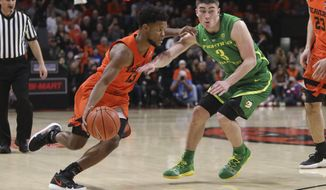 Oregon State's Antoine Vernon (13) tries to get by Oregon's Payton Pritchard (3) during the first half of an NCAA college basketball game in Corvallis, Ore., Saturday, Feb. 16, 2019. (AP Photo/Amanda Loman)