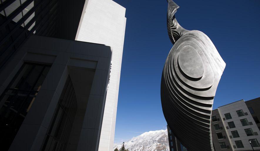 """In this Monday, Feb. 11, 2019 photo, the """"Circling Spire"""" is pictured outside of the 4th District Courthouse in Provo, Utah. The sculpture was created by Lyle London. (Evan Cobb/The Daily Herald via AP)"""