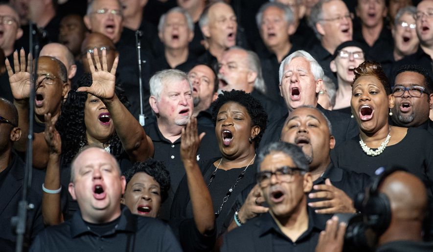 Choir members sing worship songs during the Southern Baptist Convention's annual meeting on Tuesday, June 12, 2018, at the Kay Bailey Hutchison Convention Center in Dallas. (AP Photo/Jeffrey McWhorter) ** FILE **
