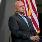 Astronaut Mark Kelly sits on stage as Democratic presidential candidate Hillary Clinton holds a rally at Iowa State University in Ames, Iowa Saturday, Jan. 30, 2016(AP. Photo/Andrew Harnik)