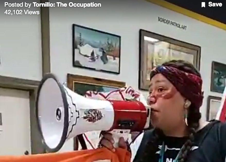 "An activist uses a megaphone inside the Border Patrol Museum near El Paso, Texas, Feb. 16, 2019. (Image: Facebook, 'Tornillo: The Occupation"" video screenshot)"