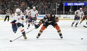 Washington Capitals left wing Alex Ovechkin, left, shoots the puck as Anaheim Ducks defenseman Hampus Lindholm defends during the third period of an NHL hockey game Sunday, Feb. 17, 2019, in Anaheim, Calif. The Ducks won 5-2. (AP Photo/Mark J. Terrill)