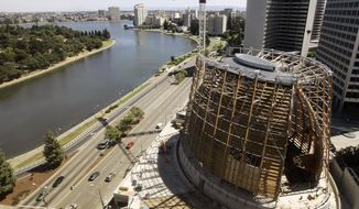"""This July 12, 2007, file photo shows construction on The Cathedral of Christ the Light in Oakland, Calif. The $190 million building is the seat of the Roman Catholic Diocese of Oakland, which lost its old cathedral to the 1989 Loma Prieta earthquake. The Diocese of Oakland, Calif has released the names of 45 priests, deacons and religious brothers who officials say are """"credibly accused"""" of sexually abusing minors. The San Francisco Chronicle reports Monday, Feb. 18, 2019, that Oakland's list goes back to 1962 when the diocese was founded. None of the men are currently in the ministry. Of the 45 people named, 20 were priests. Most have been previously identified, but five names have not been in the public domain until now. (AP Photo/Ben Margot, File)"""