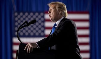 President Donald Trump speaks to a Venezuelan American community at Florida Ocean Bank Convocation Center at Florida International University in Miami, Fla., Monday, Feb. 18, 2019, to speak out against President Nicolas Maduro's government and its socialist policies. (AP Photo/Andrew Harnik)