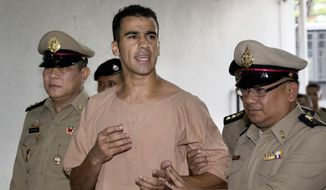 FILE -In this Monday, Feb. 4, 2019, file photo, detained Bahraini soccer player Hakeem al-Araibi arrives at the criminal court in Bangkok, Thailand. Australian Federal Police did not know Al-Araibi was a refugee who feared persecution in his homeland when the agency alerted Bahrain and Thailand that he was on a flight bound for Bangkok, a top police official said Monday. (AP Photo/Sakchai Lalit, File)