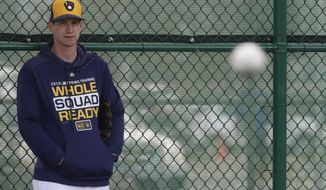 Craig Counsell watches during a spring training baseball workout Sunday, Feb. 17, 2019, in Phoenix. (AP Photo/Morry Gash)