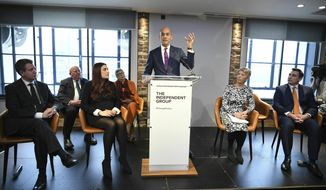 Labour MP Chuka Umunna, center, speaks to the media during a press conference with a group of six other Labour MPs, in London, Monday, Feb. 18, 2019. Seven British lawmakers say they are quitting the main opposition Labour Party over its approach to issues including Brexit and anti-Semitism. Many Labour lawmakers are unhappy with the party's direction under leader Jeremy Corbyn, a veteran socialist who took charge in 2015 with strong grass-roots backing. (Stefan Rousseau/PA via AP)