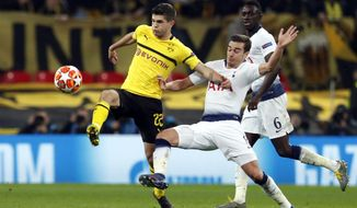 Tottenham midfielder Harry Winks fights for the ball with Dortmund midfielder Christian Pulisic, left, during the Champions League round of 16, first leg, soccer match between Tottenham Hotspur and Borussia Dortmund at Wembley stadium in London, Wednesday, Feb. 13, 2019. (AP Photo/Alastair Grant)
