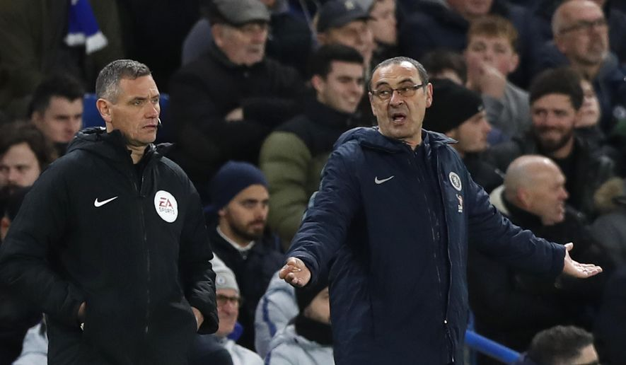 Chelsea head coach Maurizio Sarri gestures when looking at the fourth official during the English FA Cup fifth round soccer match between Chelsea and Manchester United at Stamford Bridge stadium in London, Monday, Feb. 18, 2019. (AP Photo/Alastair Grant)