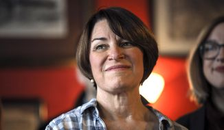 Sen. Amy Klobuchar, D-Minn., listens as she is introduced during a campaign stop at The Village Trestle in Goffstown, N.H., Monday, Feb. 18, 2019. (AP Photo/Cheryl Senter)