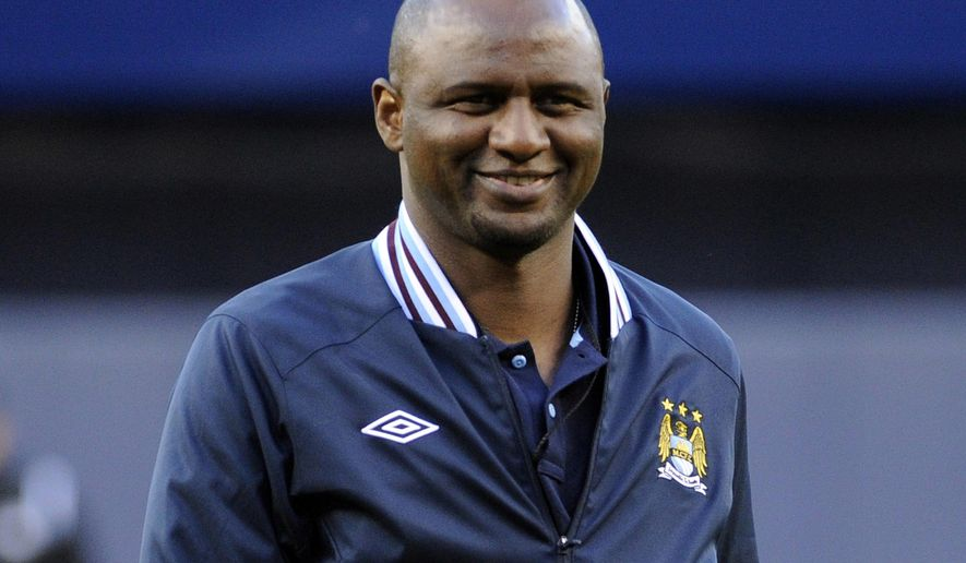 FILE - In this Friday, May 17, 2013 file photo, Patrick Vieira smiles after throwing out the first pitch before the New York Yankees and Toronto Blue Jays play a baseball game, at Yankee Stadium in New York.  Nice coach Patrick Vieira took the rare step of publicly criticizing his player Allan Saint-Maximin after the winger declared himself unfit to play at Angers, Saturday Feb. 16, 2019. (AP Photo/Bill Kostroun, FILE)