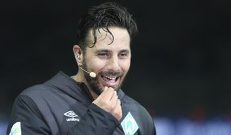 In this Saturday, Feb. 16, 2019 photo Bremen's Claudio Pizarro smiles during an interview after the German Bundesliga soccer match between Hertha BSC Berlin and Werder Bremen in Berlin. The veteran Werder Bremen striker became the oldest to score in the Bundesliga on Saturday with his injury-time equalizer for a 1-1 draw at Hertha Berlin, gaining what could be a crucial point for his side in its fight for European qualification (Andreas Gora/dpa via AP)