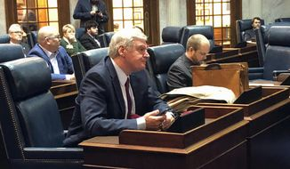 Indiana Family Institute president Curt Smith listens after testifying before the Indiana Senate Public Policy Committee against a proposed state hate crimes law on Monday, Feb. 18, 2019, in Indianapolis. The committee voted 9-1 to endorse the bill after hearing nearly three hours of public testimony from opponents and supporters. (AP Photo/Tom Davies)