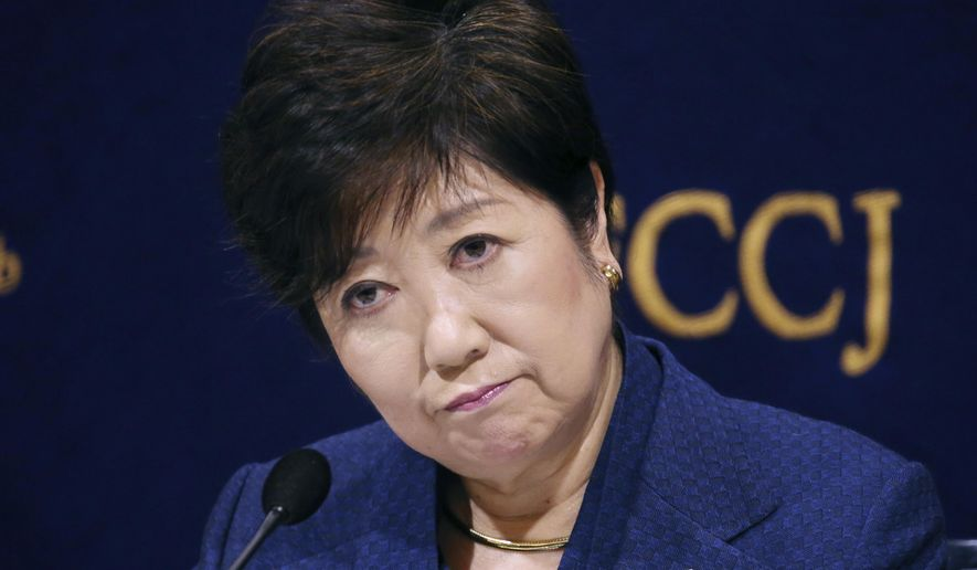 Governor of Tokyo Yuriko Koike reacts during a press conference in Tokyo, Monday, Feb. 18, 2019. Gov. Koike has declined to weigh in on the future Japanese Olympic Committee President Tsunekazu Takeda. Takeda is being investigated for his part in a bribery scandal that French investigators believe may have helped Tokyo win the 2020 Olympics in a vote by the International Olympic Committee.(AP Photo/Koji Sasahara)