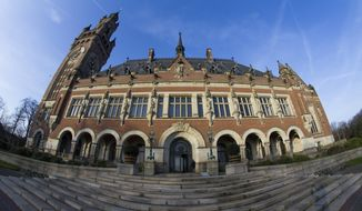 Exterior view of the Peace Palace, which houses the International Court of Justice, or World Court, in The Hague, Netherlands, Monday, Feb. 18, 2019. India is taking Pakistan to the United Nations' highest court in an attempt to save the life of an Indian naval officer sentenced to death last month by a Pakistani military court after being convicted of espionage. (AP Photo/Peter Dejong)