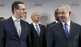 """File -- In this Thursday, Feb. 14, 2019 photo Poland's Prime Minister Mateusz Morawiecki, left, and Israeli Prime Minister Benjamin Netanyahu, right, attend a group photo during a meeting in Warsaw, Poland. Poland's prime minister canceled plans for his country to send a delegation to meeting in Jerusalem on Monday after the acting Israeli foreign minister Israel Katz said that Poles """"collaborated with the Nazis"""" and """"sucked anti-Semitism from their mothers' milk"""". (AP Photo/Michael Sohn)"""