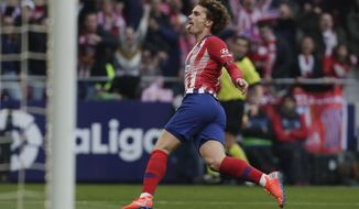 Atletico Madrid's Antoine Griezmann celebrates after scoring his sides 1st goal during a Spanish La Liga soccer match between Atletico Madrid and Real Madrid at the Metropolitano stadium in Madrid, Spain, Saturday, Feb. 9, 2019. (AP Photo/Manu Fernandez)